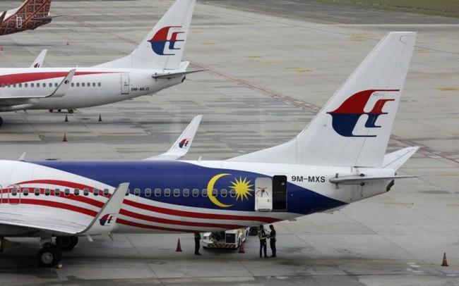 """Khách Malaysia bay sang Việt Nam phải đóng """"phí chia tay"""" bao nhiêu?"""