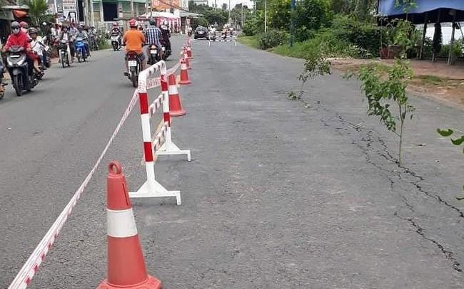 Quốc lộ 91 xuất hiện vết nứt mặt đường đe dọa sạt lở nhà dân