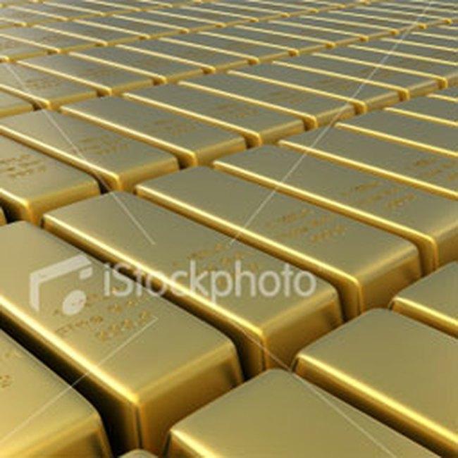 Giá vàng thấp nhất trong 5 tuần, giá dầu về mức 70USD/thùng