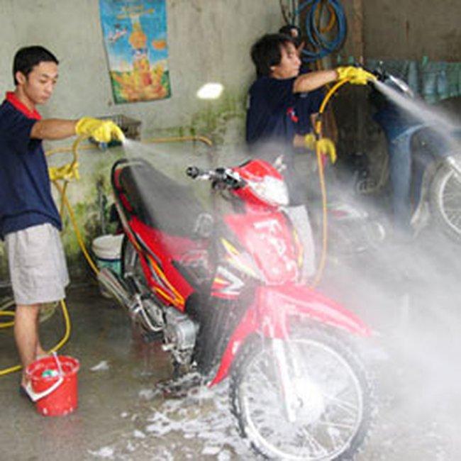 Hà Nội sẽ tiến hành thu phí rửa xe