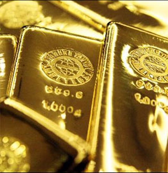 Giá vàng giảm nhẹ, USD tăng giá