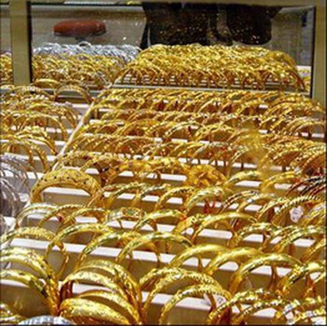 Vàng thế giới giảm sâu, USD tự do vượt 19.900 đồng