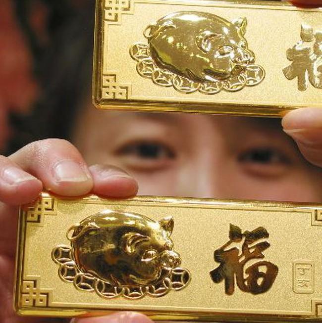 Giá vàng nhảy vọt lên 1.387USD/ounce sau thông tin Trung Quốc đẩy mạnh đầu tư vàng