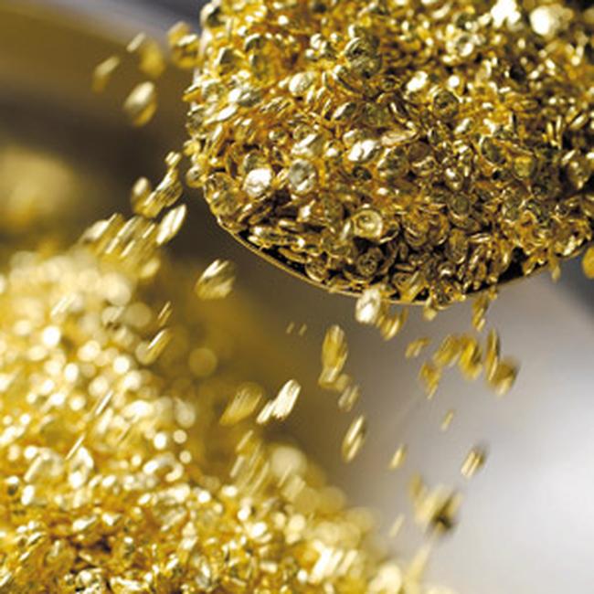 Giá vàng hạ xuống 1.380USD/ounce, dầu lập kỷ lục mới trong 2 năm