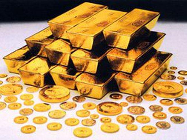 Giá vàng giảm mạnh xuống 1.418 USD/ounce do USD mạnh lên so với EUR