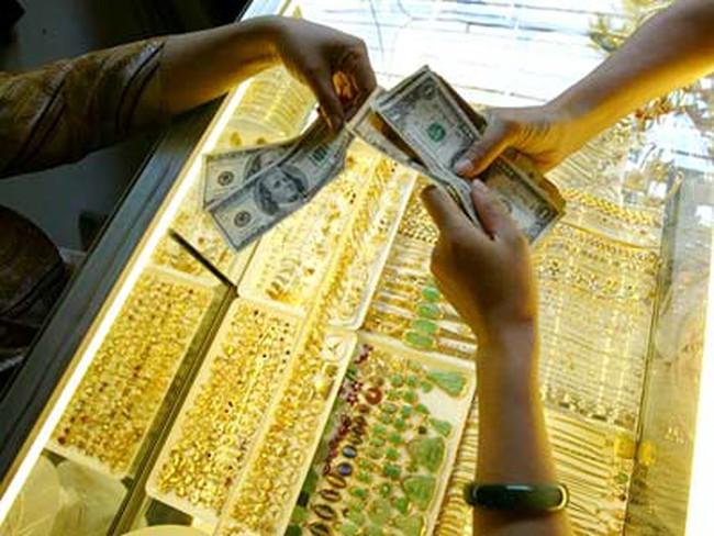 Tái diễn thu đổi USD ở tiệm vàng