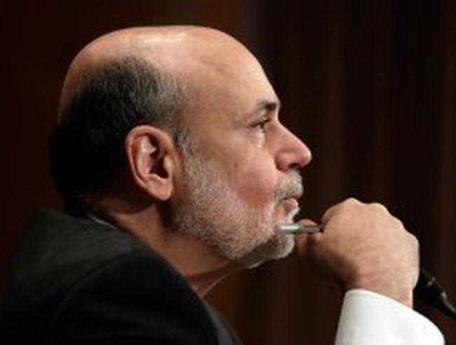 Fed duy trì tốc độ mua trái phiếu