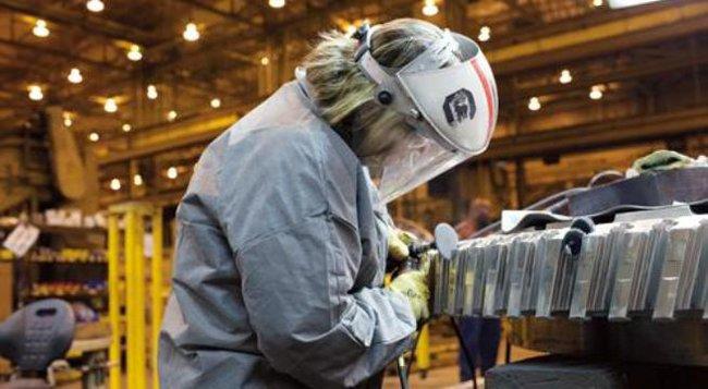 Kinh tế Mỹ tiếp tục tăng trưởng chậm trong tháng 9