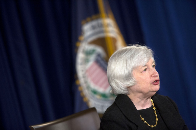 Fed tiếp tục cắt giảm QE, giữ nguyên lãi suất