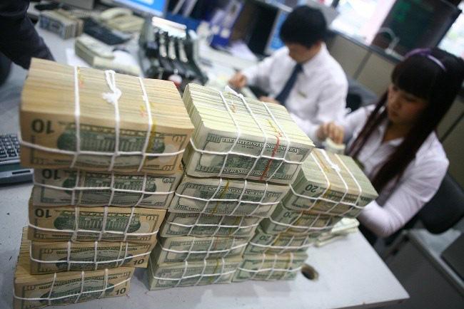Tỉ giá USD tăng: Cầu thật hay đầu cơ?