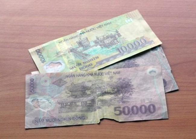 Ngân hàng Nhà nước sẵn sàng đổi tiền cũ, rách cho người dân