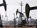 Đà tăng giá dầu bị hạn chế vì thông tin từ IEA