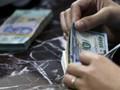 Standard Chartered dự báo tiền VND mất giá nhẹ