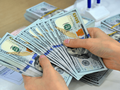 NHNN: Cân đối cung cầu ngoại tệ vẫn tương đối thuận lợi