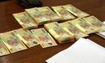 Bắt đôi nam nữ liều lĩnh mang tiền giả gửi ngân hàng
