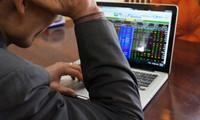 Fed tuyên bố không tăng lãi suất, chứng khoán Mỹ và giá dầu giảm cùng chiều