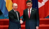 Tổng thống Nga Putin tặng kem cho Chủ tịch Trung Quốc Tập Cận Bình