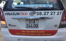 Bộ Công Thương đang xem xét việc dán khẩu hiệu phản đối Uber, Grab