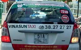 Tài xế taxi gỡ bỏ biểu ngữ phản đối Uber, Grab