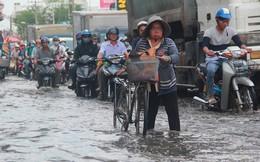 Người dân TPHCM sống chung với ngập nước
