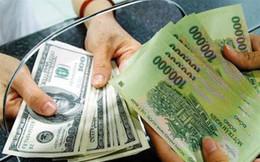 Bị bắt tại ngân hàng khi đổi 1000 tờ USD