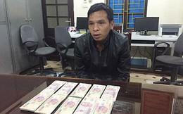 Bắt đối tượng rao bán tiền Việt Nam giả qua mạng zalo