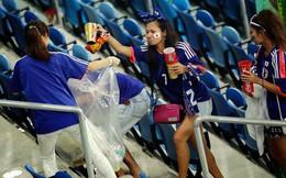 Cổ động viên Nhật bản ở lại sân dọn rác sau khi đội nhà chiến thắng Colombia tại World Cup