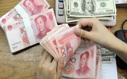 """Tỷ giá Nhân dân tệ ở thị trường tài chính quốc tế vượt """"làn ranh đỏ"""" 7"""