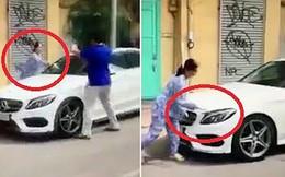 Vụ người phụ nữ đập xe ở quận 1: Đậu ôtô trước nhà phố đúng hay sai?
