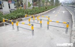 Người đi xe đạp toát mồ hôi hì hục vượt rào ở đường đi bộ dài nhất Thủ đô