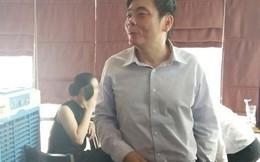 Xuất hiện sau khám xét, ông Trần Vũ Hải từ chối trả lời báo chí