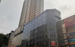 Cao ốc 15 năm không xong, lại 'tranh nhau' bán căn hộ