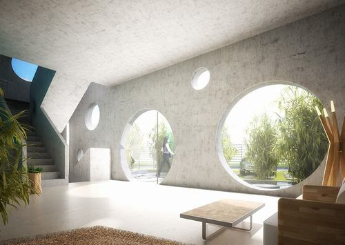 Phòng khách thoáng rộng, tràn ngập ánh sáng và cây xanh được bố trí ngay lối vào nhà.