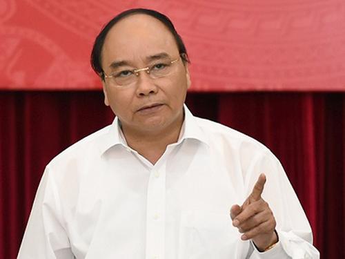 Thủ tướng Nguyễn Xuân Phúc đã yêu cầu sửa đổi các điều kiện kinh doanh xuất khẩu gạo. Ảnh: VGP