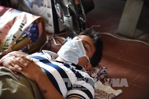 Bệnh nhân nhiễm virus cúm H1N1 điều trị tại bệnh viện ở Ahmedabad, Ấn Độ. Ảnh: AFP/TTXVN