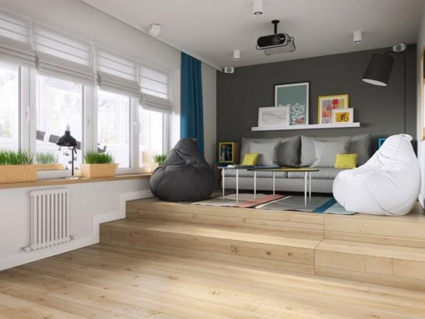 """Phòng khách được thiết kế đặc biệt với sàn gỗ được nâng cao hai bậc. Đây cũng chính là không gian nghỉ ngơi lý tưởng của chủ nhà với chiếc giường được """"giấu"""" bên dưới."""