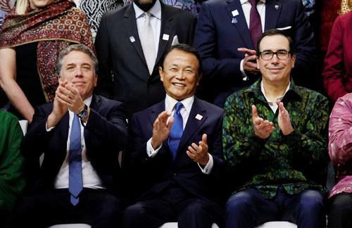 Nhiều tranh cãi phủ bóng kinh tế địa cầu - Ảnh 1.