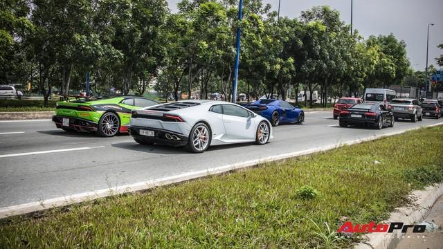Những siêu xe hàng đầu Việt Nam nối đuôi, khuấy động Sài Gòn - Ảnh 23.