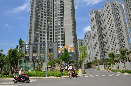 Bộ Xây dựng thừa nhận giới đầu cơ thổi giá nhà đất để thu lợi bất chính - Ảnh 1.