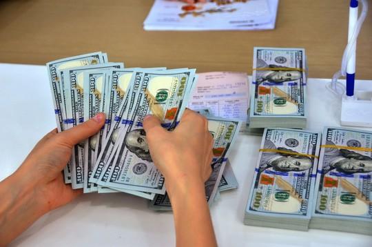 Cảnh báo chiêu chuyển tiền đen ra nước ngoài - Ảnh 1.