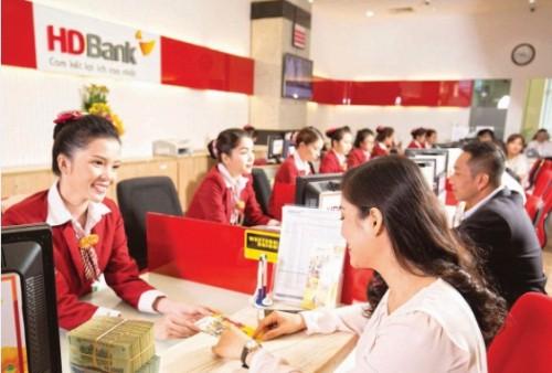 Không thể để ngân hàng lẻ loi xử lý tài sản bảo đảm - Ảnh 1.