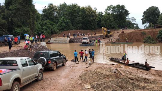 Tường thuật từ nơi vỡ đập thủy điện Lào: Chỉ còn một sốh dùng trực thăng, ca-nô để cứu người - Ảnh 3.