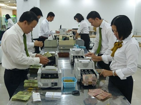 Tái cơ cấu ngân hàng còn đối mặt với nhiều thách thức - Ảnh 1.