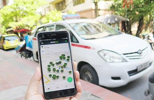 Hiệp hội Taxi tiếp tục đấu căng với Grab - Ảnh 1.