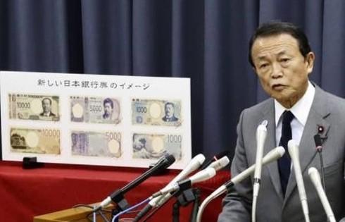 Nhật Bản lưu hành tiền giấy mới - Ảnh 1.