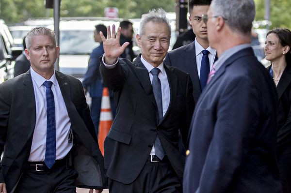 Bữa tối giữa các nhà đàm phán thương mại Mỹ - Trung và quả tạ thuế quan lủng lẳng trên đầu - Ảnh 1.