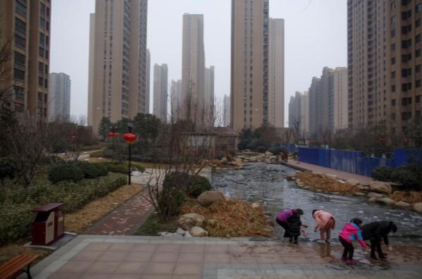 Bong bóng tài sản dần thành hình tại các thành phố ở Trung Quốc - Ảnh 2.