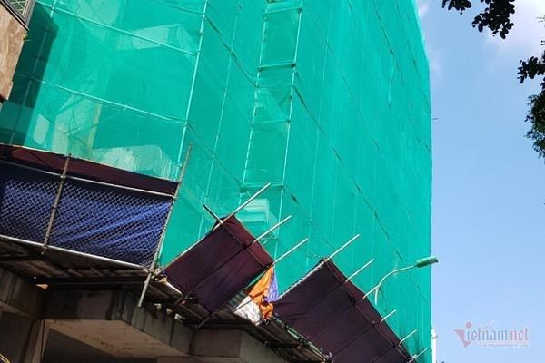 Hết thời hạn, cao ốc sai phép vẫn 'chình ình' trên đất trung tâm Hà Nội - Ảnh 2.