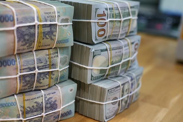 Dự trữ ngoại hối ước 70 tỷ USD, tiền bán vốn từ BIDV có thể giúp ổn định tỷ giá - Ảnh 1.