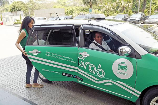 Dừng thí điểm taxi công nghệ, ứng dụng gọi xe Grab và Go-Viet có tiếp tục được hưởng lợi? - Ảnh 1.
